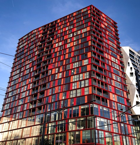The red building called the Calypso Building where We ARE Renewables is located.